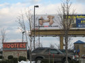 MyLameSexLife.com billboard, next to a Hooters restaurant.