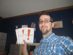 Kevin holding copies of Outspoken.