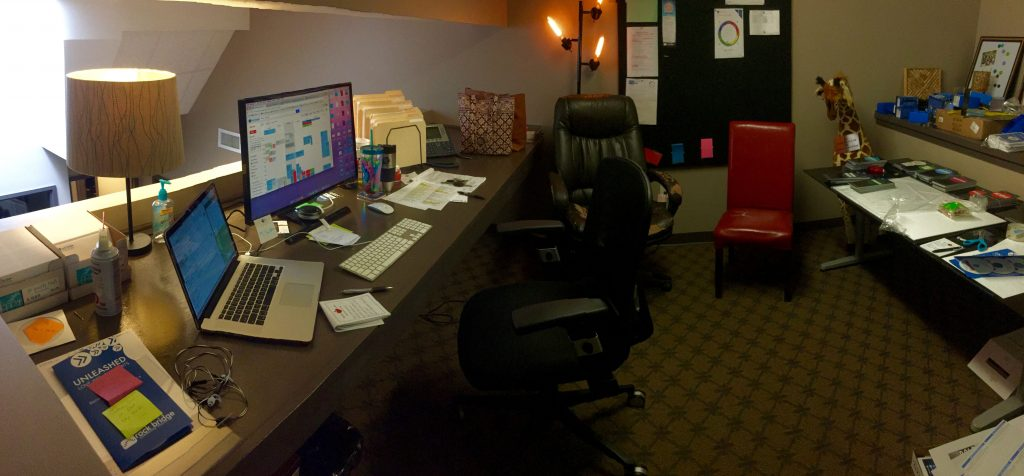 Click to see a panoramic view of Sarah's shared work space.